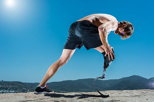 Low Angle Of Prosthetic Athlete In Pain stock photo