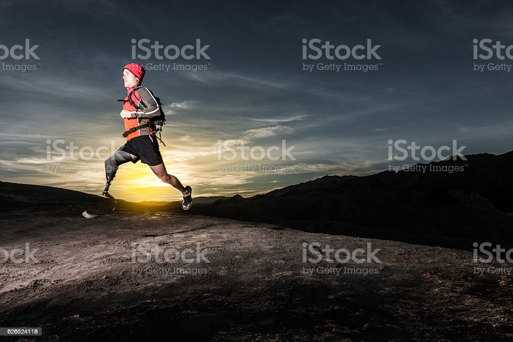 Low Angle Of Prosthetic Leg Running AT Sunrise stock photo