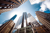 istock low angle of tall building in manhattan 1291177121