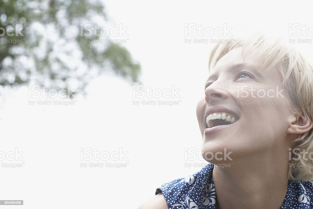 Low angle of woman smiling royalty-free stock photo