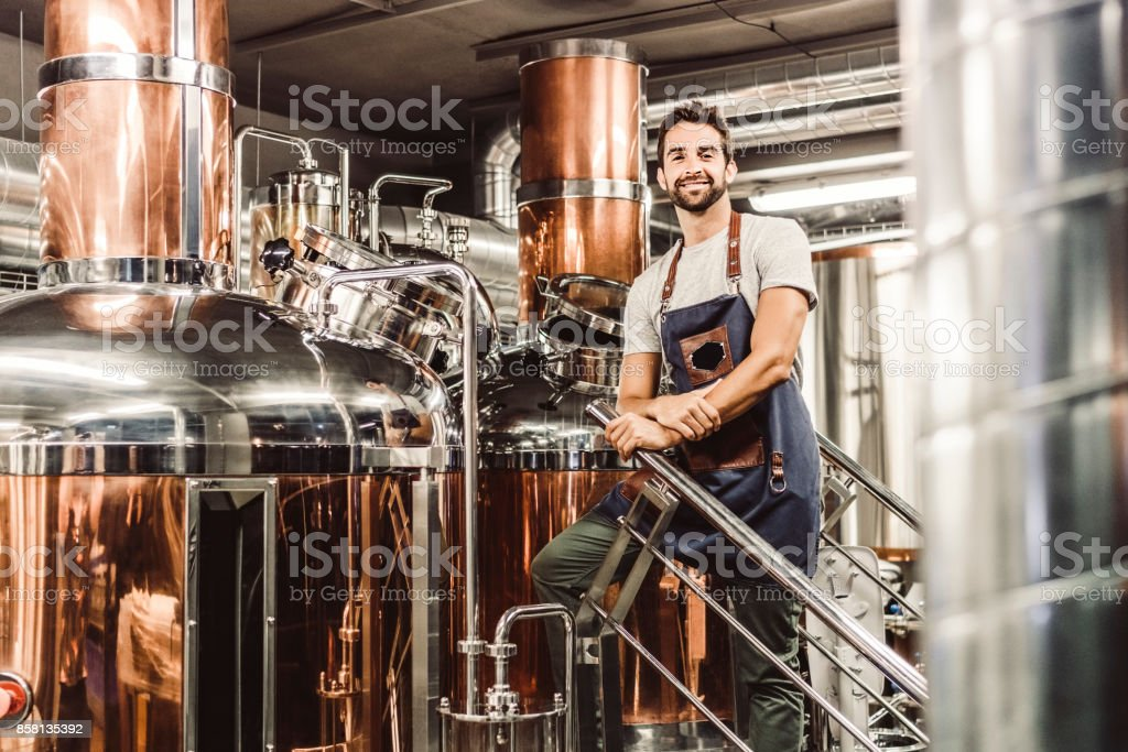 Low angle portrait of male manager at brewery stock photo