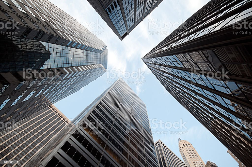 Low angle shot of blue sky through skyscrapers stock photo