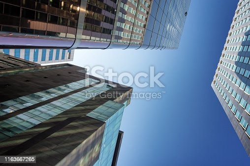 istock Low angle shot of high skycrapers in central seoul city, South Korea 1163667265