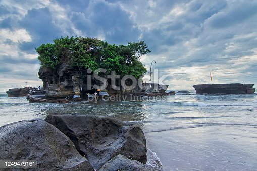 Low angle shot the beach and Tanah Lot main temple as the background