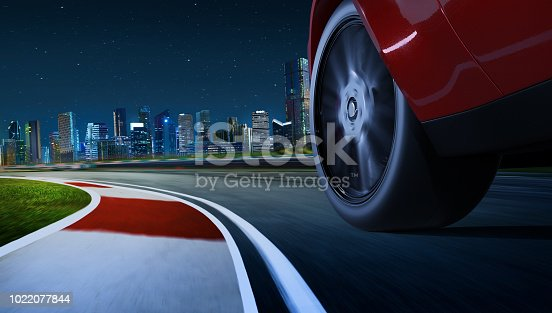 688980174istockphoto Low angle side view of car driving fast 1022077844