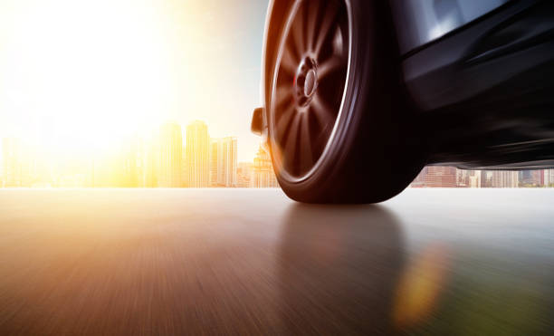 Low angle side view of car driving fast stock photo