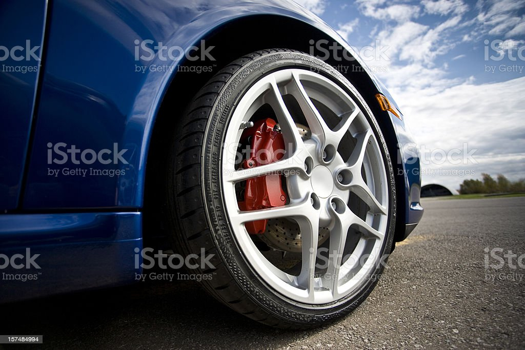 Low angle sports car tire stock photo