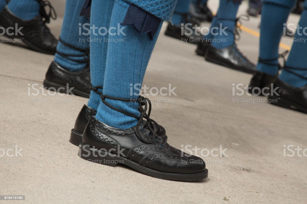 Low angle traditional scottish shoes blue stockings stock photo