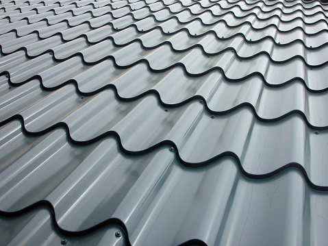 A metallic roof tile field viewed in perspective