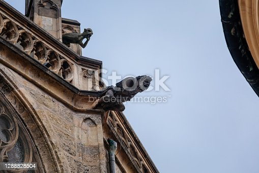 istock Low angle view at a part of Medieval stone St. Bartholomew´s Church in autumn day, arched windows, chimeras and gargoyles, Gothic Cathedral, Kolin, Central Bohemia, Czech republic, November 28, 2020 1288828504