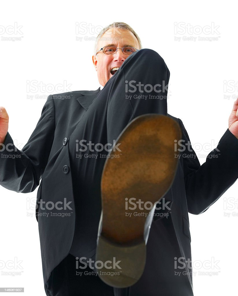 Low angle view of a businessman with raised leg royalty-free stock photo