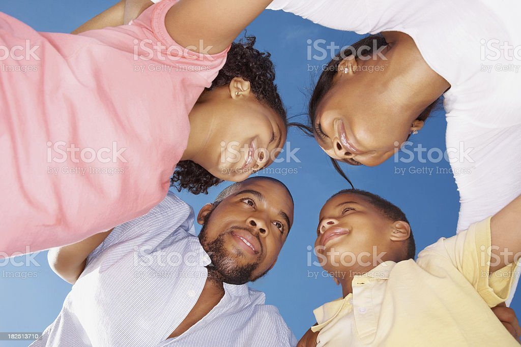 Low angle view of a family forming huddle royalty-free stock photo
