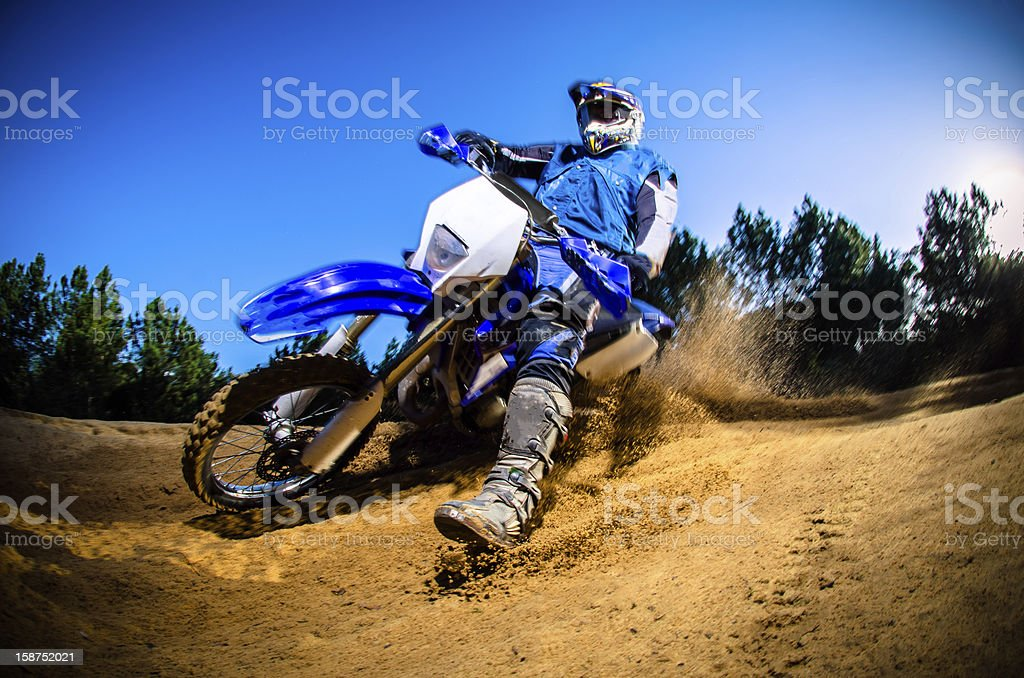 A low angle view of a motorcyclist on a dirt course stock photo