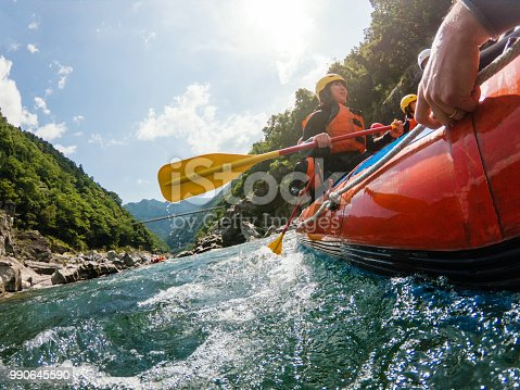 Low angle view of a white water river rafting excursion