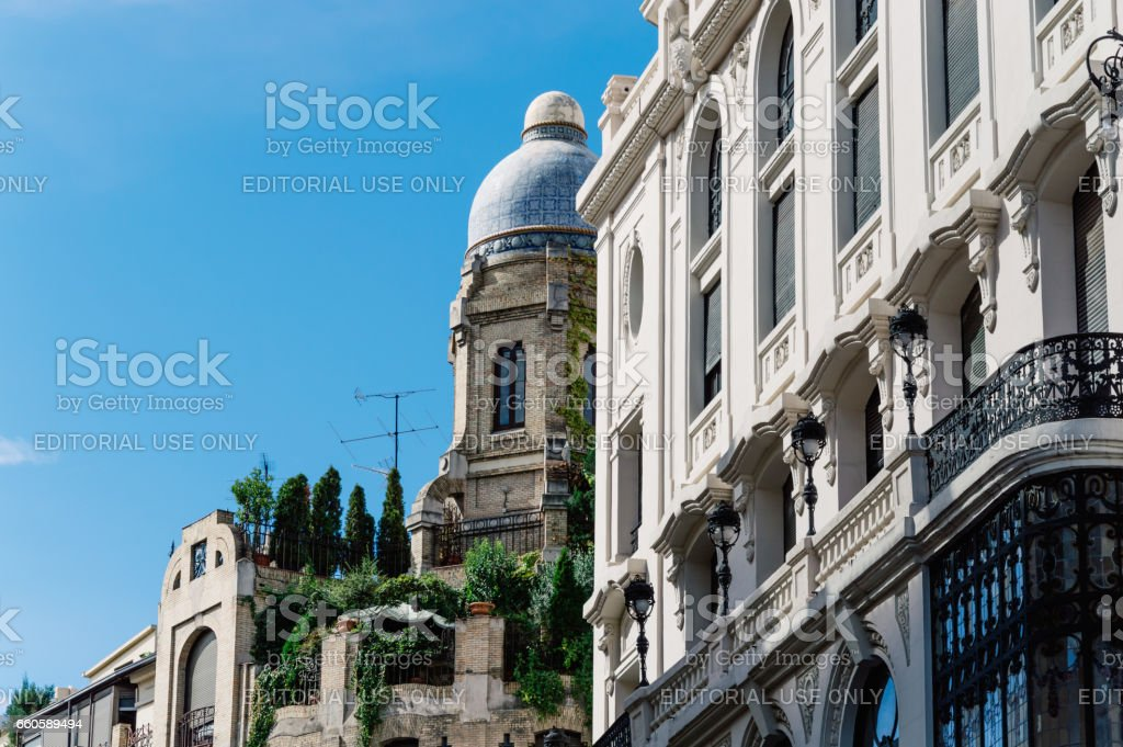 Low angle view of  buildings at Gran Via Street in Madrid. Dome in penthouse against cloudy sky stock photo