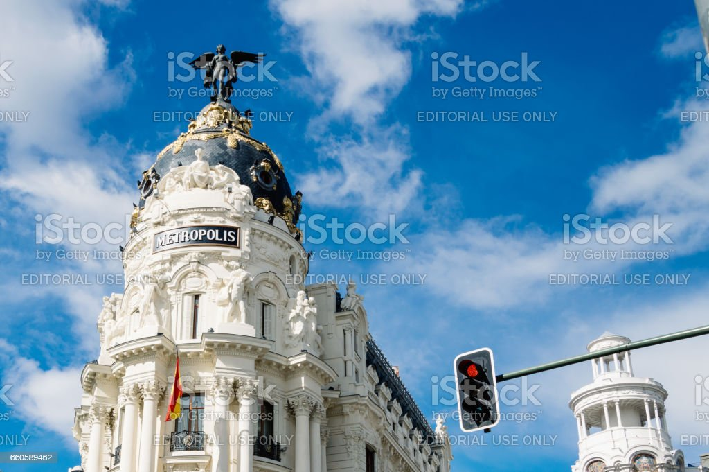 Low angle view of  buildings at Gran Via Street in Madrid. Metropolis building against cloudy sky stock photo