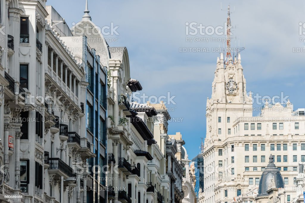 Low angle view of  buildings at Gran Via Street in Madrid. Telefonica Building on background stock photo