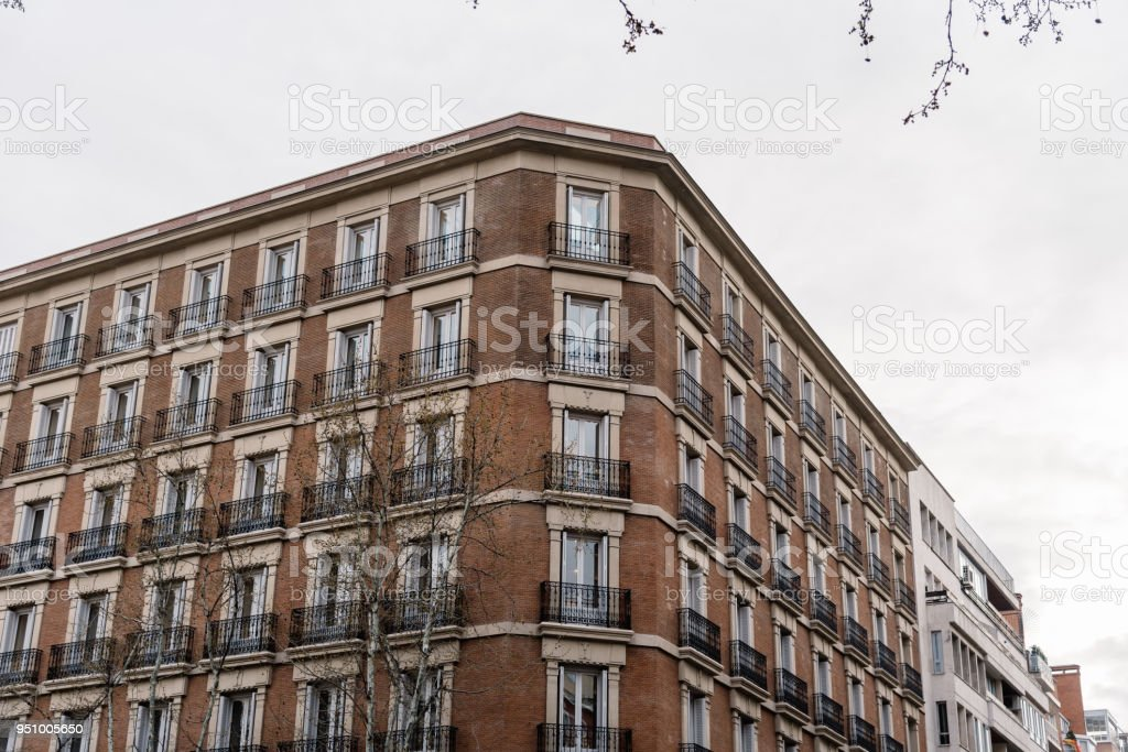 Low angle view of buildings in street of residential district stock photo