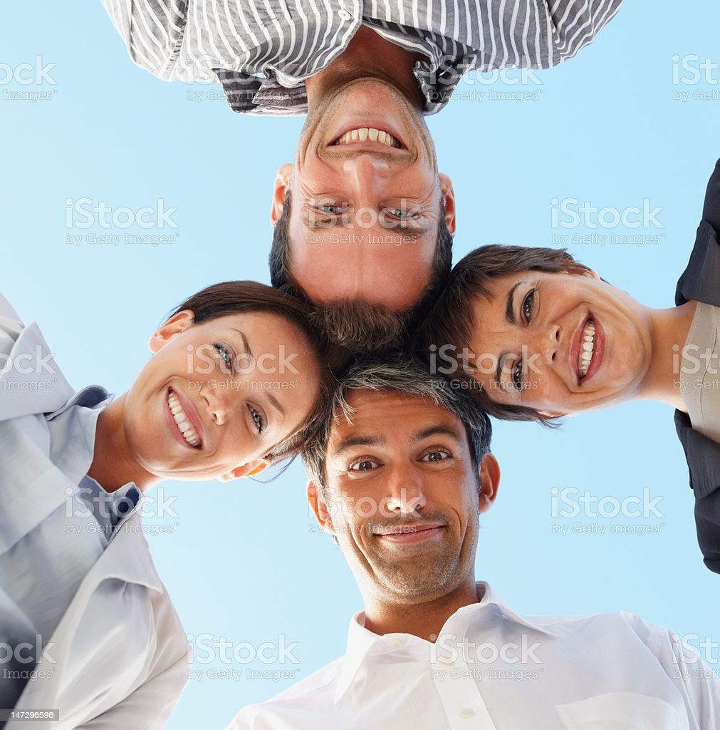 Low angle view of business colleagues smiling royalty-free stock photo