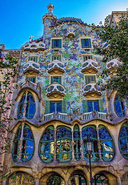 Low angle view of Casa Batllo in Barcelona, Spain Barcelona, Spain - July 18, 2016: Casa Batllo is a building located in Barcelona and is one of Gaudi's artworks. Vertical composition. Low angle view shot.  casa batllo stock pictures, royalty-free photos & images