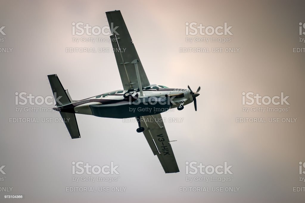 Low angle view of Cessna Caravan 1000 airplane in flight. stock photo
