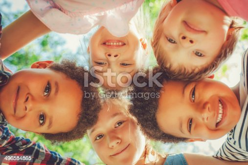 istock Low angle view of children in a park 496584865