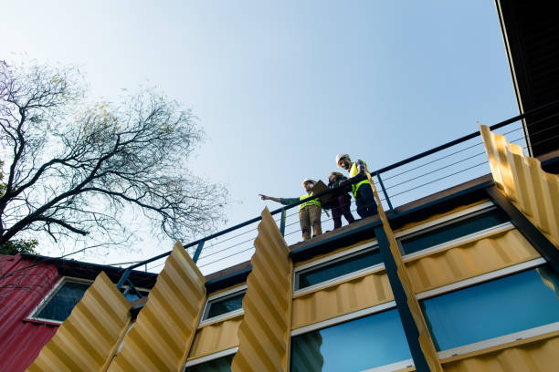 Low angle view of construction managers standing on green building stock photo