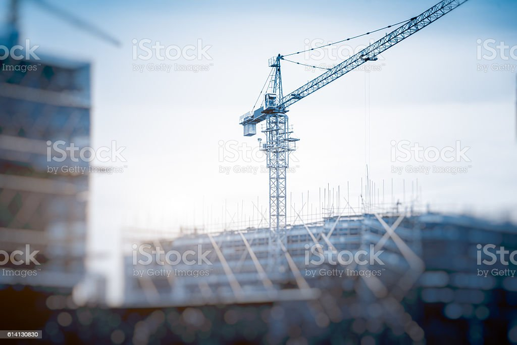 Low Angle View Of Cranes against skyline royalty-free 스톡 사진