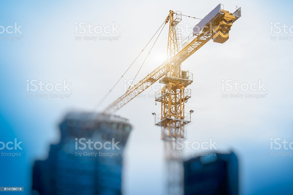 Low Angle View Of Cranes against skyline stock photo