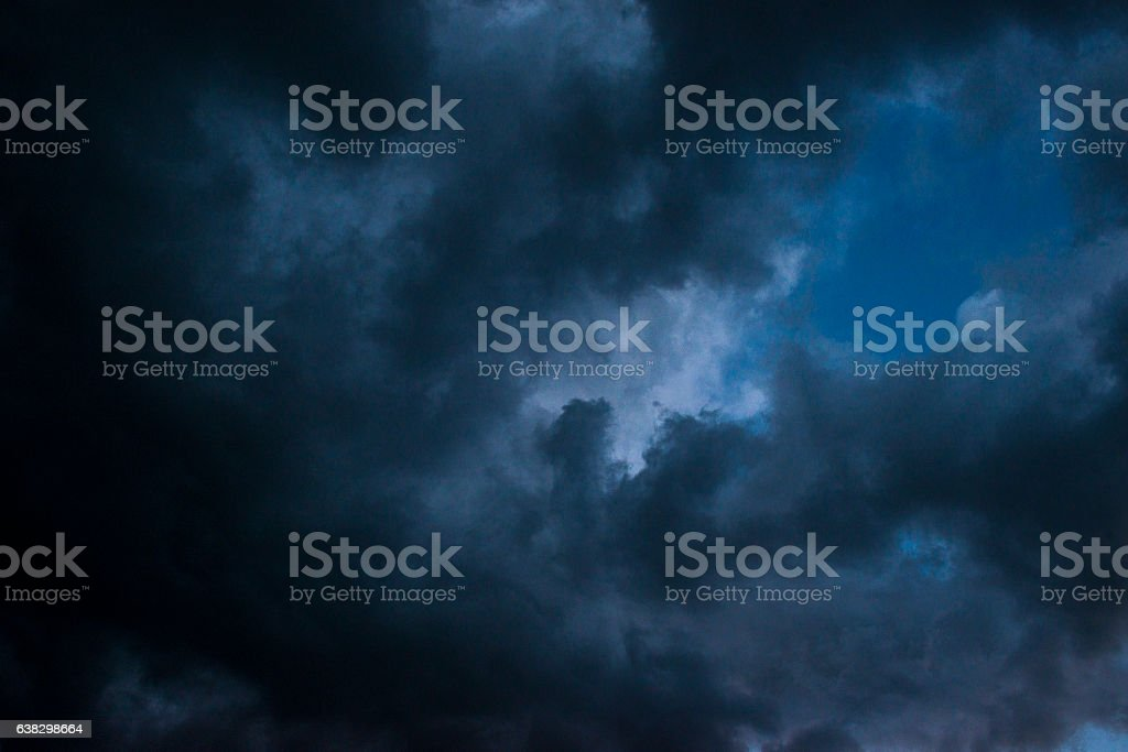 Low angle view of dark clouds on the sky stock photo