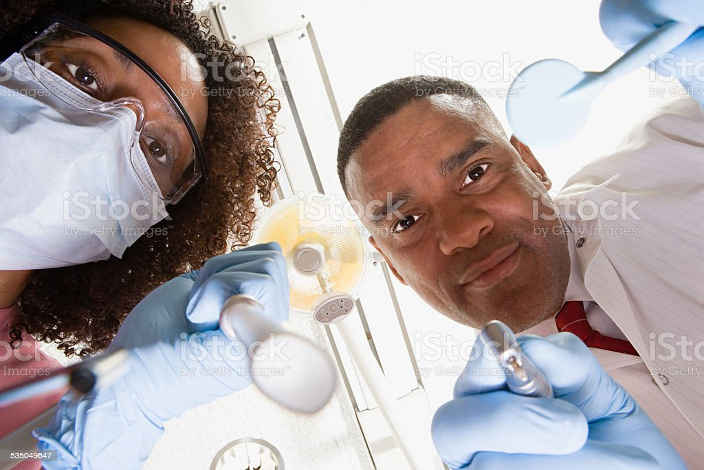 Low angle view of dentist and dental nurse stock photo