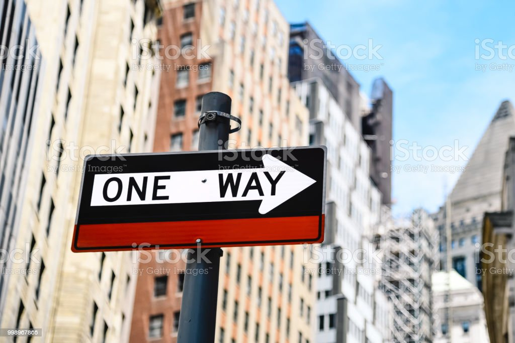 Low angle view of directional sign against buildings in New York stock photo