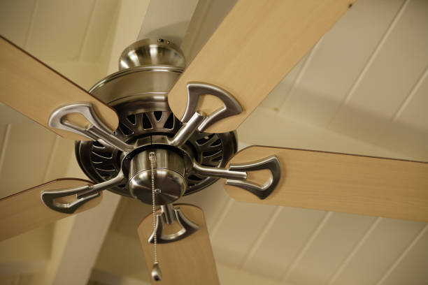 Low angle view of fan at the ceiling Low angle view of fan at the ceiling ceiling fan stock pictures, royalty-free photos & images