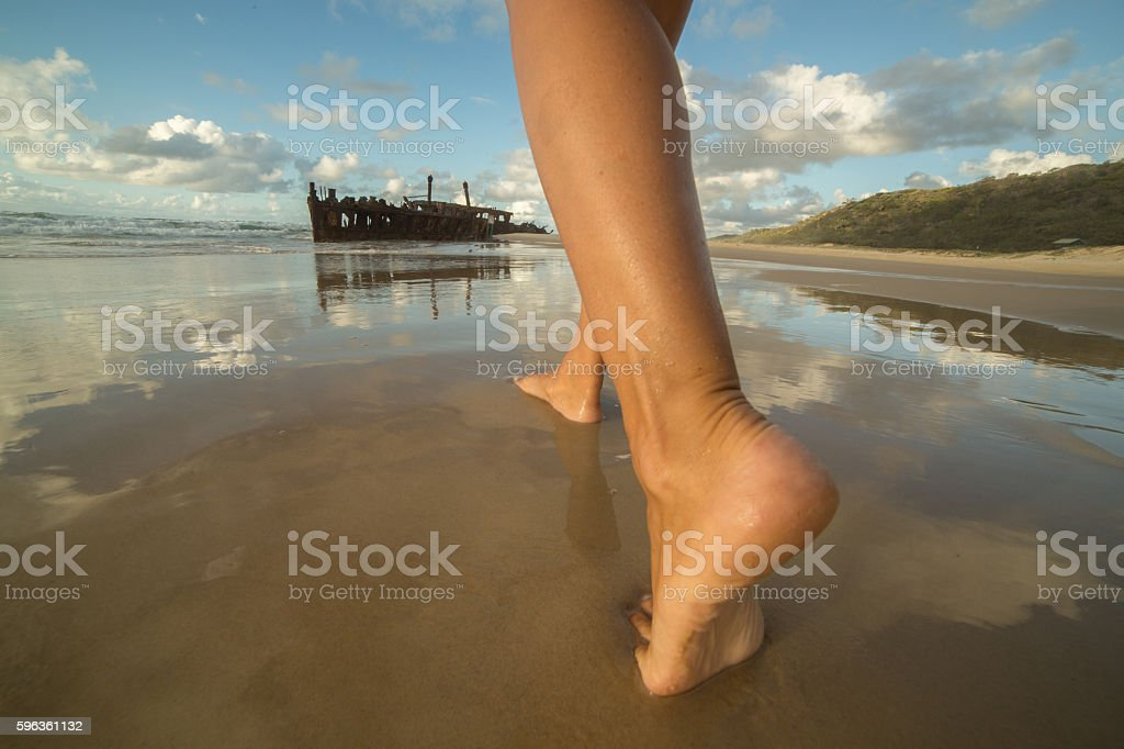 Low angle view of female legs walking on beach-Fraser Island royalty-free stock photo