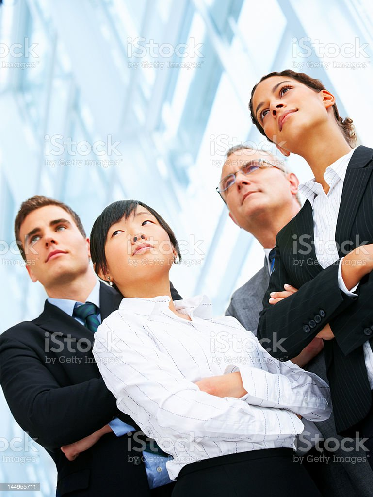 Low angle view of four business people posing royalty-free stock photo