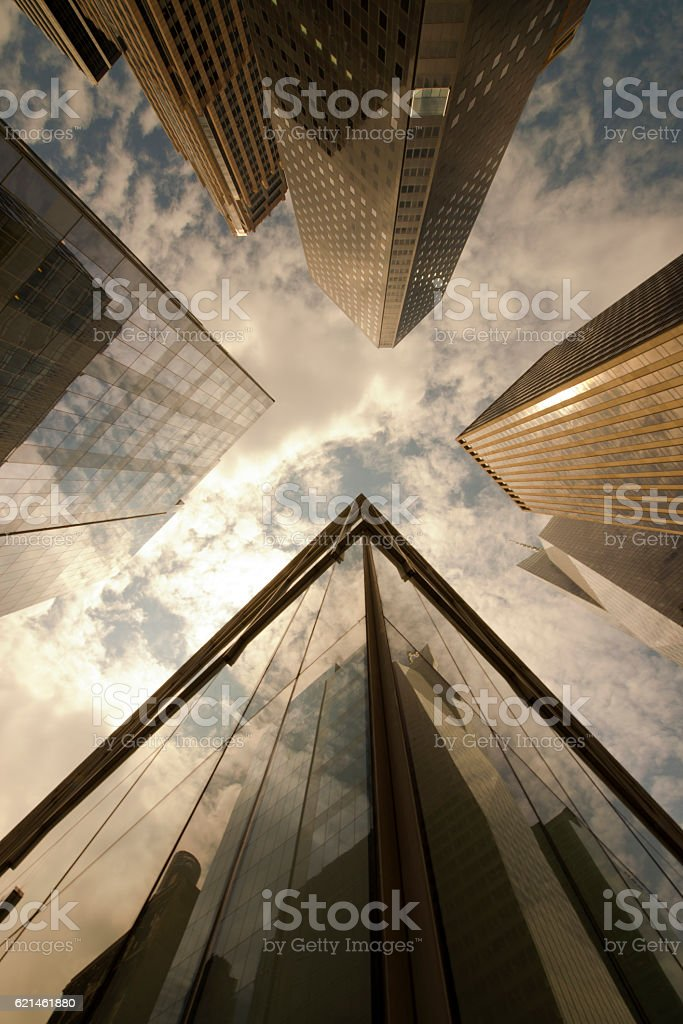 Low angle view of glass and steel skyscrapers stock photo