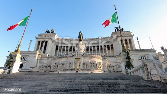 Low angle view of Italian National Monument to Vittorio Emanuele II or Vittoriano with Altar of the Fatherland located at historic Piazza Venezia in ancient downtown Rome