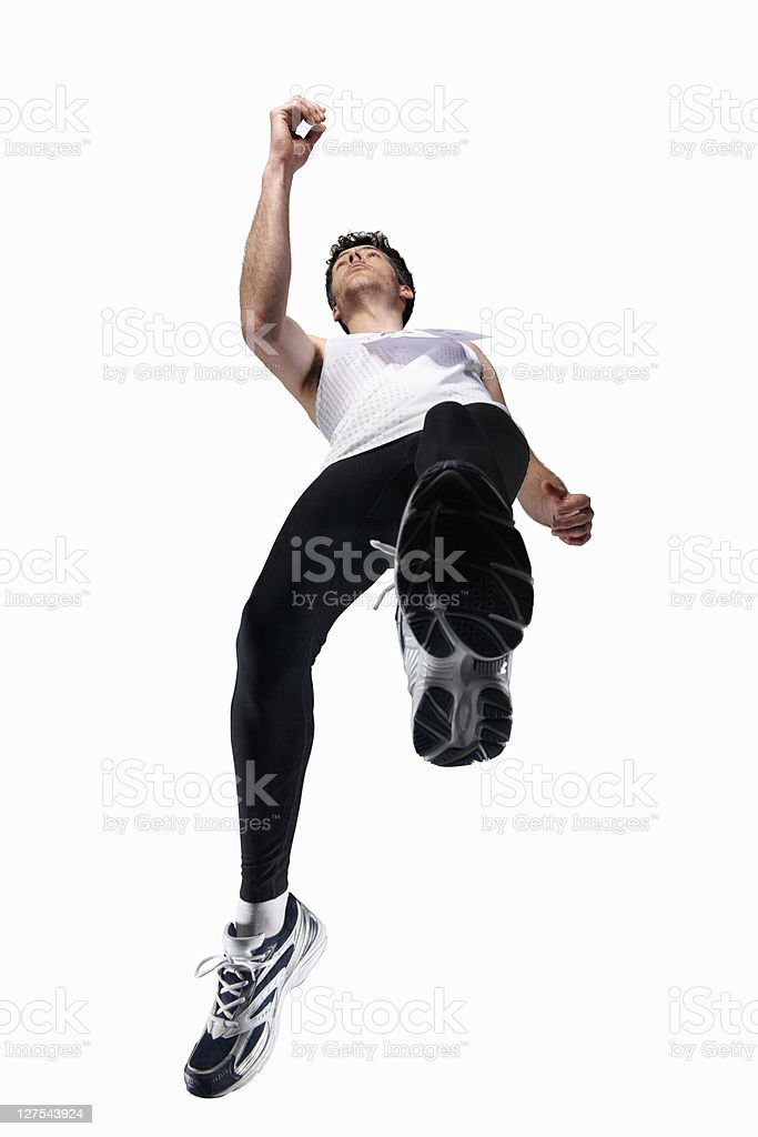 Low angle view of man jogging stock photo