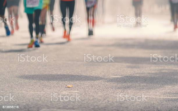 Low angle view of marathon runners running in sunny street blurred picture id873858216?b=1&k=6&m=873858216&s=612x612&h=tifa47i8hozvd770xjawd zj5rgcclyt8n kan2xfns=