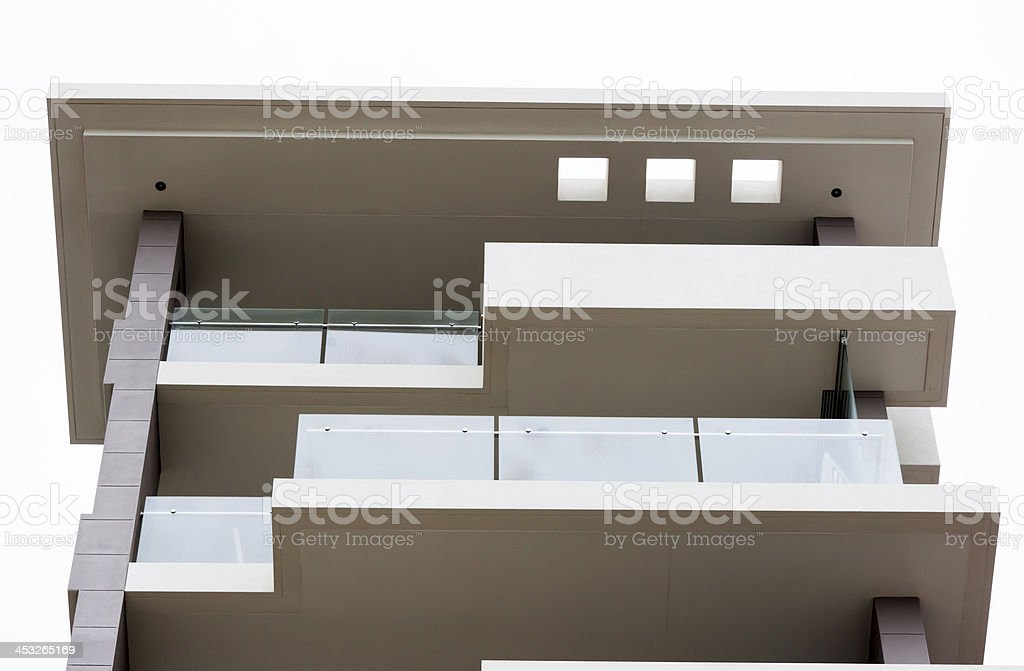 Low angle view of modern apartment block with glass balcony stock photo