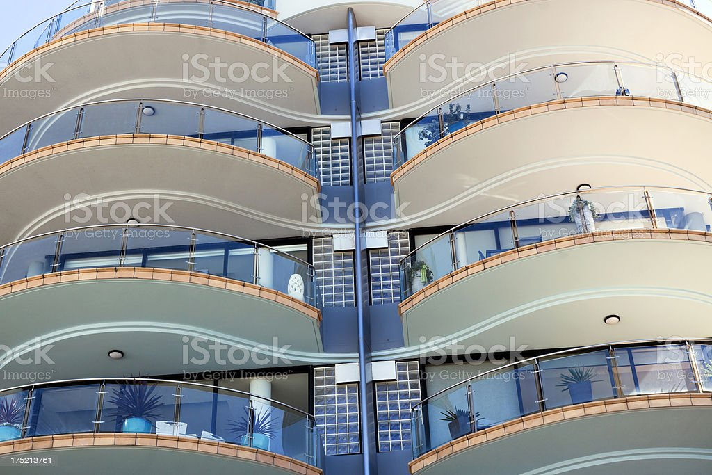Low angle view of modern apartment block with round balconies royalty-free stock photo