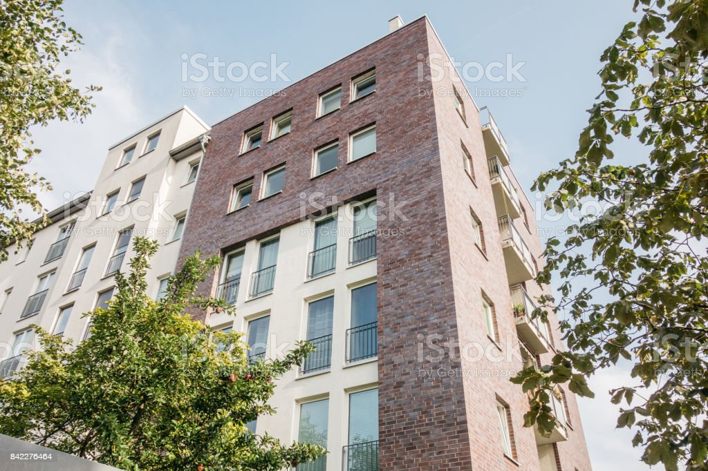 low angle view of modern brick building stock photo