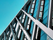 istock Low Angle View of Modern Building Exterior Against Clear Blue Sky 1294271535