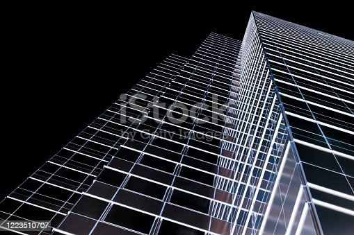Low angle view of modern office building at night, negative image technic, skyscrapers, black background with copy space, full frame horizontal composition