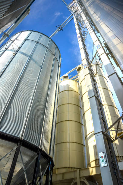 Low angle view of new grain silo in metal stock photo
