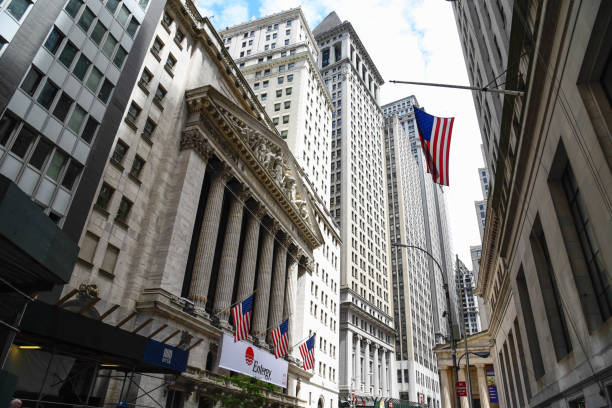 low angle view of  new stock stock exchange building in new york - wall street lower manhattan stock pictures, royalty-free photos & images