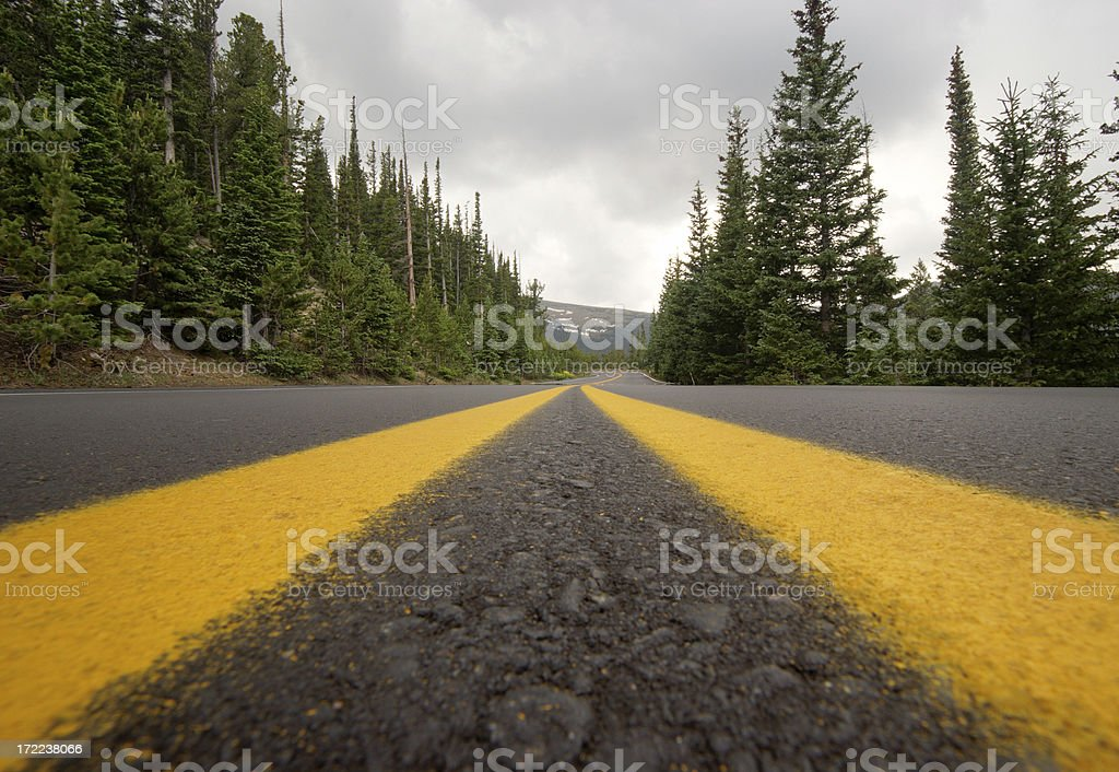 Low Angle View of Newly Paved Road on Stormy Day. stock photo