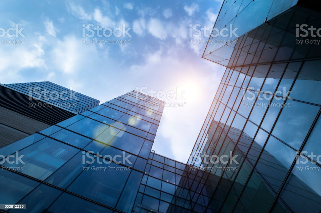 low angle view of office building exterior with sunshine stock photo