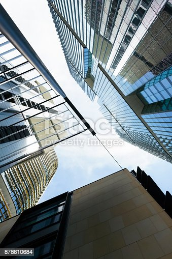 istock Low angle view of office buildings, skyscrapers, abstract background 878610684