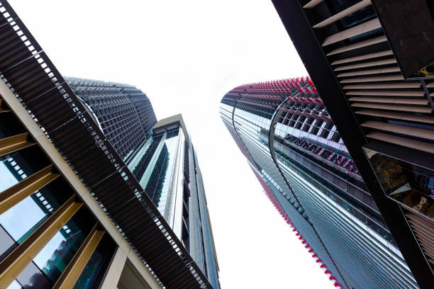 low angle view of office buildings, white background, copy space - barangaroo stock photos and pictures